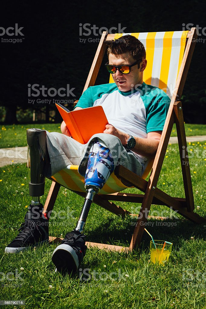 Amputee reading in the Garden stock photo