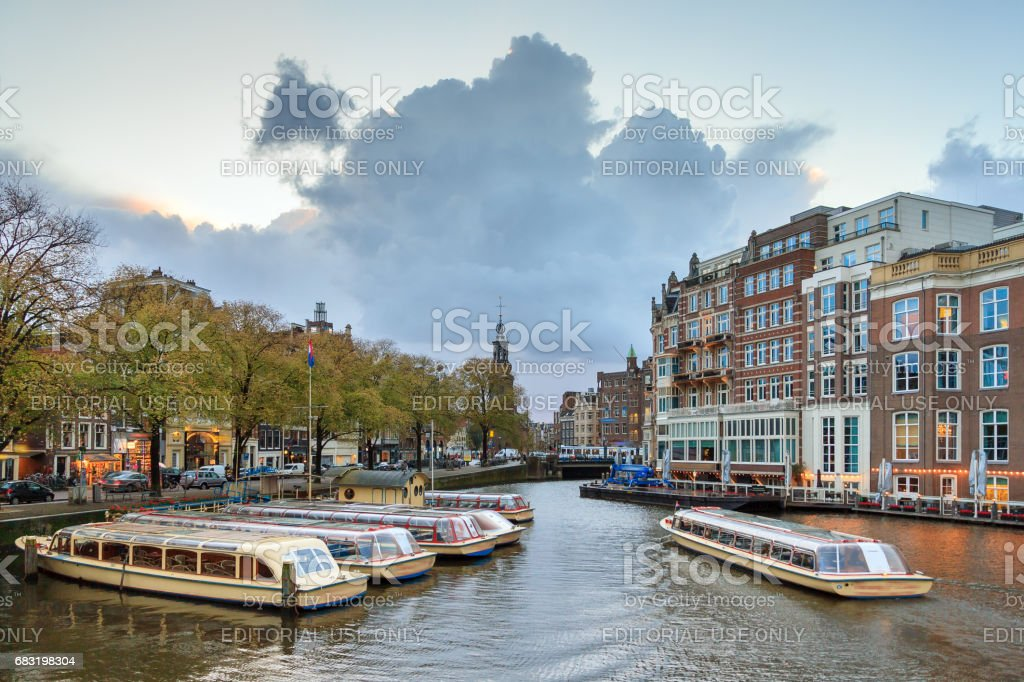 Amstel canal boats Amsterdam stock photo