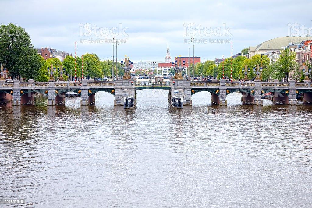 Amstel canal bridge, Amsterdam stock photo