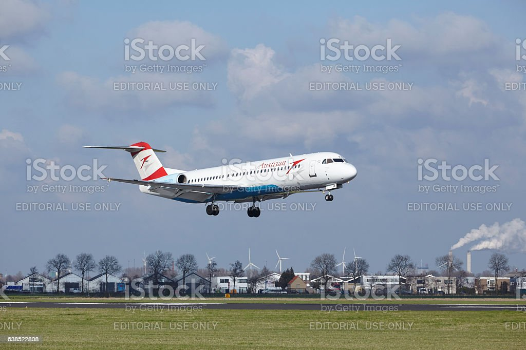 Amsterdam Airport Schiphol - Austrian Airlines Fokker 100 lands stock photo