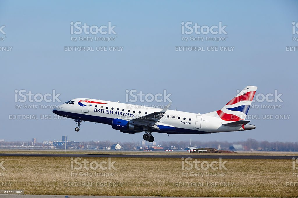Amsterdam Airport Schiphol - British Airways Embraer 170 takes off stock photo