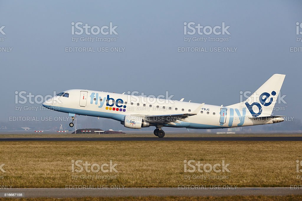 Amsterdam Airport Schiphol - Embraer 190 of Flybe takes off stock photo