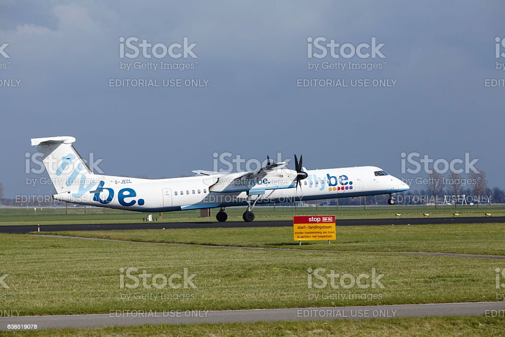 Amsterdam Airport Schiphol - Flybe Bombardier Dash 8 lands stock photo
