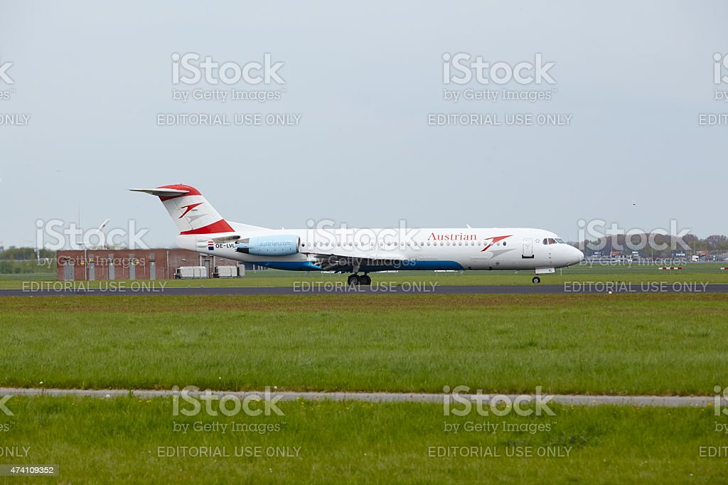 Amsterdam Airport Schiphol - Fokker 100 of Austrian Airlines lands stock photo