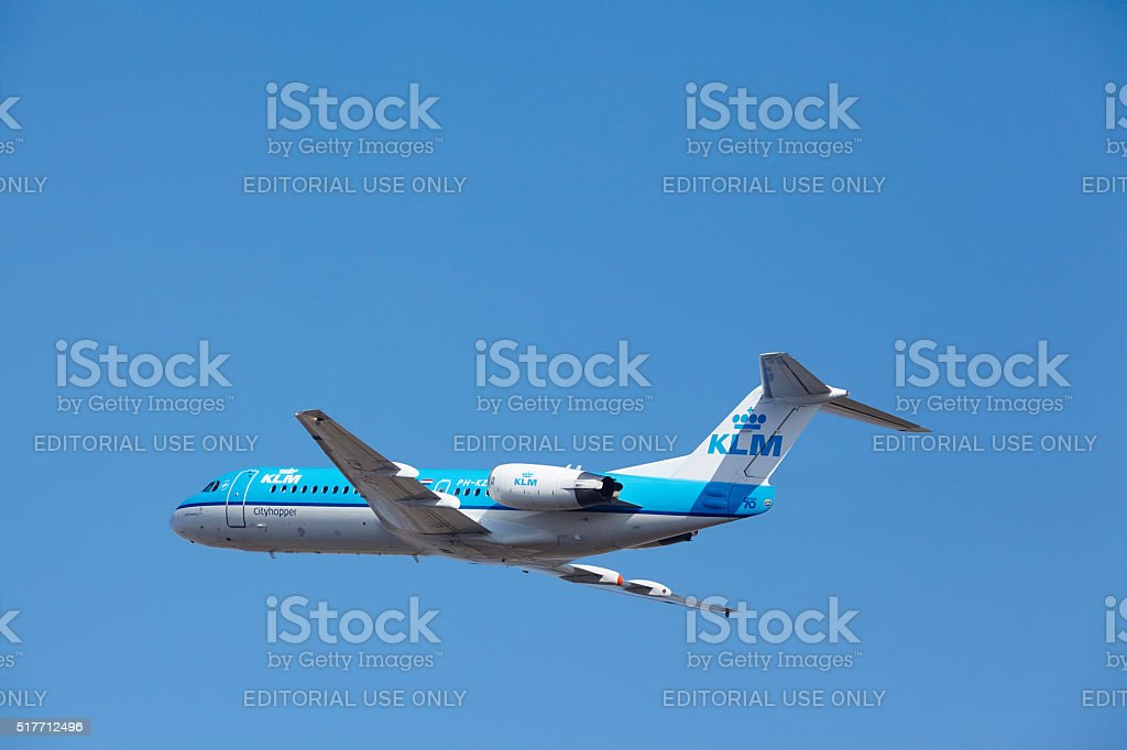 Amsterdam Airport Schiphol - KLM Cityhopper Fokker 70 takes off stock photo