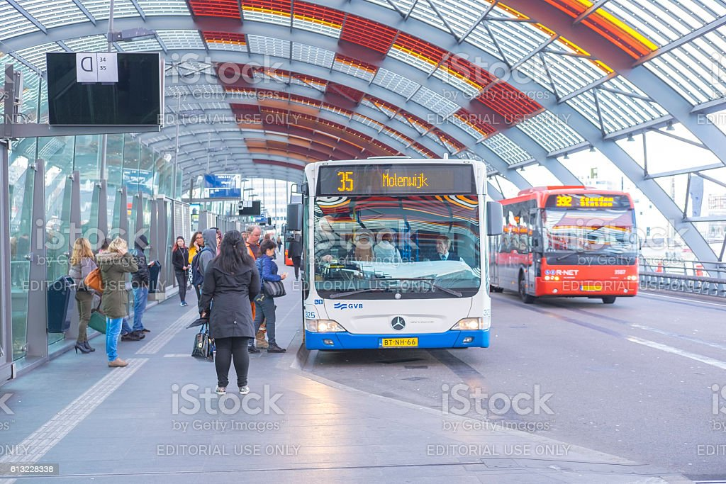 Amsterdam bus station with people boarding the busses stock photo
