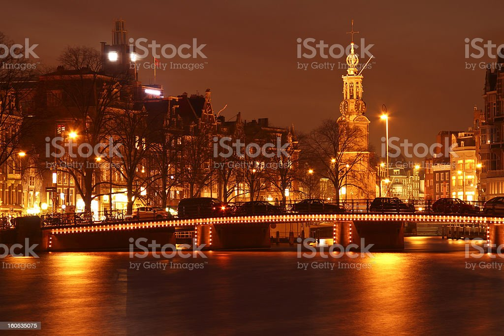 Amsterdam by night with the Munt tower in Netherlands stock photo