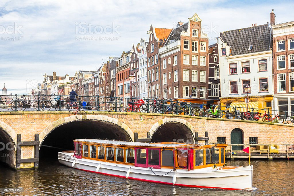 Amsterdam canal and bicycles stock photo