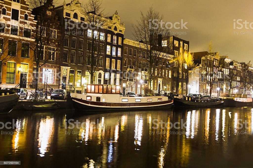 Amsterdam canal and bridge at night stock photo