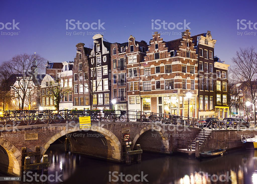 Amsterdam canal and traditional houses at night royalty-free stock photo