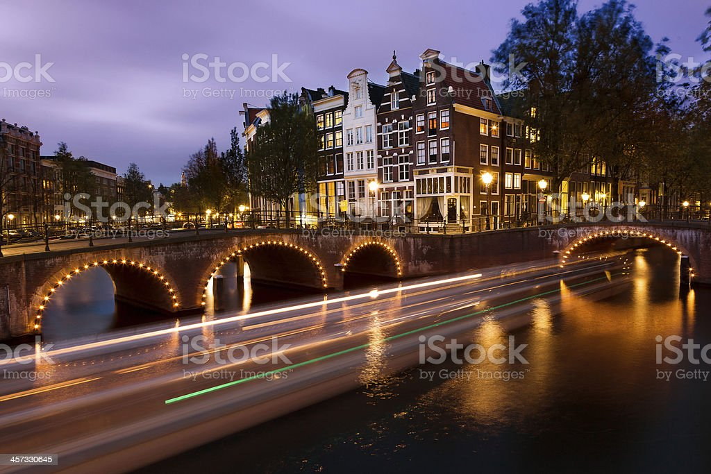 Amsterdam canal boat trails stock photo