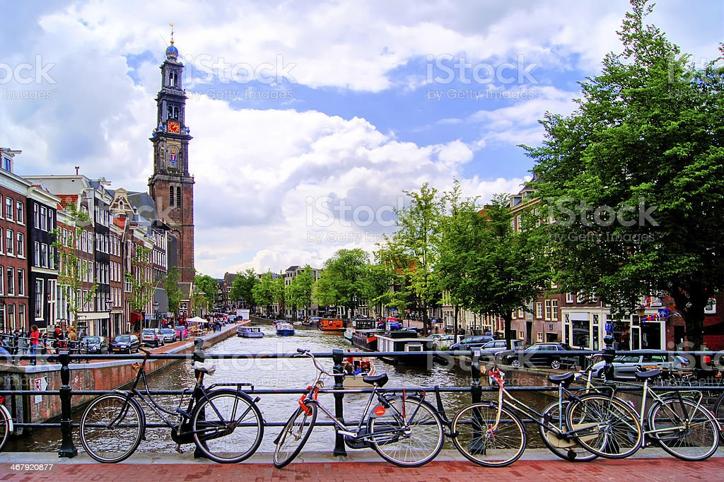 Amsterdam canal scene with church and bicycles stock photo