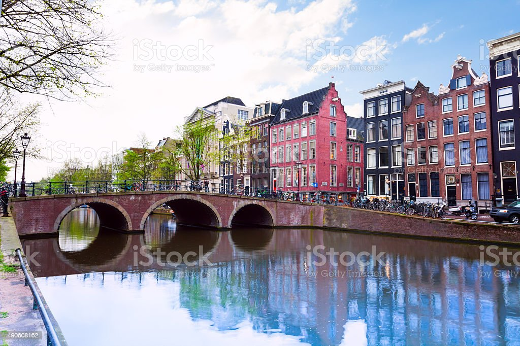 Amsterdam canal view with river and houses stock photo