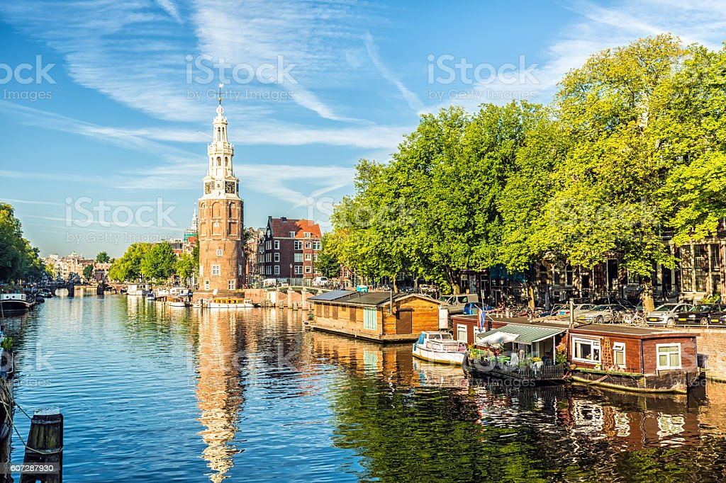 Amsterdam Canal with houseboats and ships stock photo