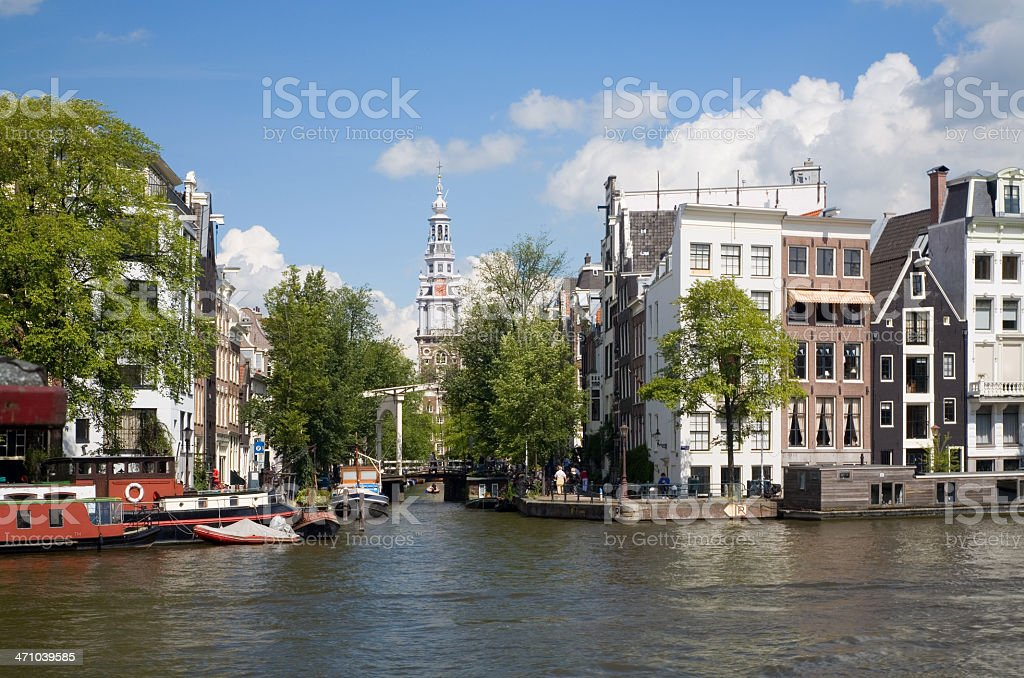 Amsterdam canal with typical houses royalty-free stock photo