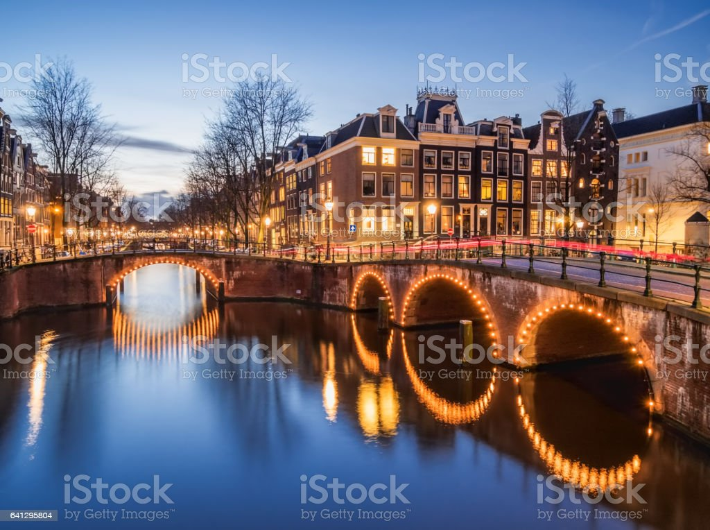 Amsterdam canals and bridges in the evening stock photo
