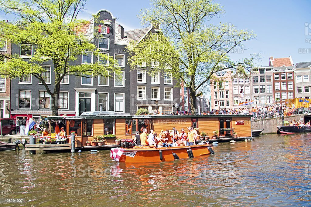 Amsterdam canals full of boats and people on queensday Netherlands stock photo