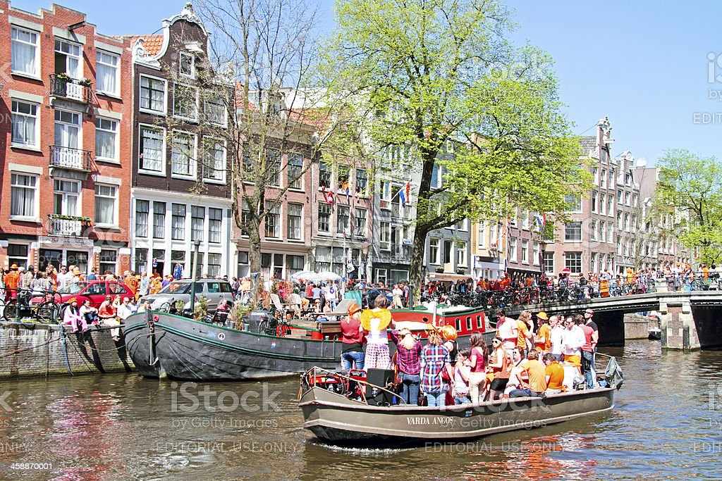 Amsterdam canals full of boats to celebrate queensday in Netherlands royalty-free stock photo