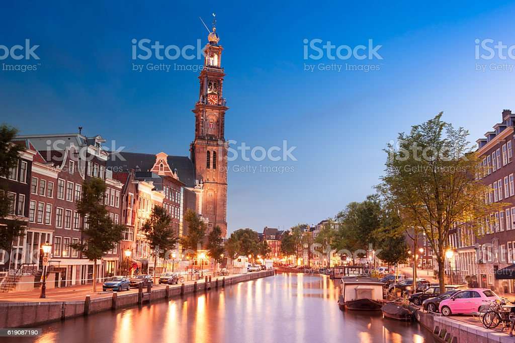 Amsterdam canals in front of Westkerk and Anne Frank museum stock photo