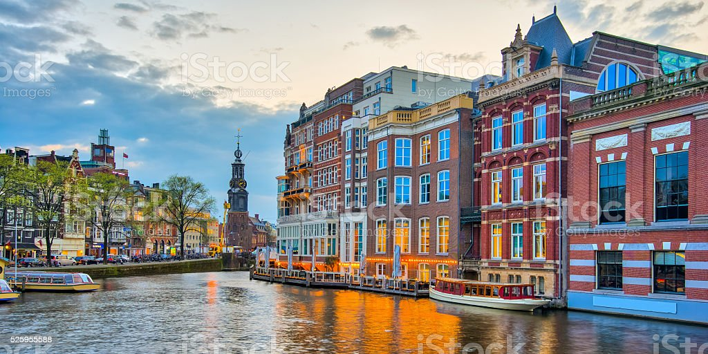 Amsterdam canals with bridge and typical dutch houses in Netherl stock photo