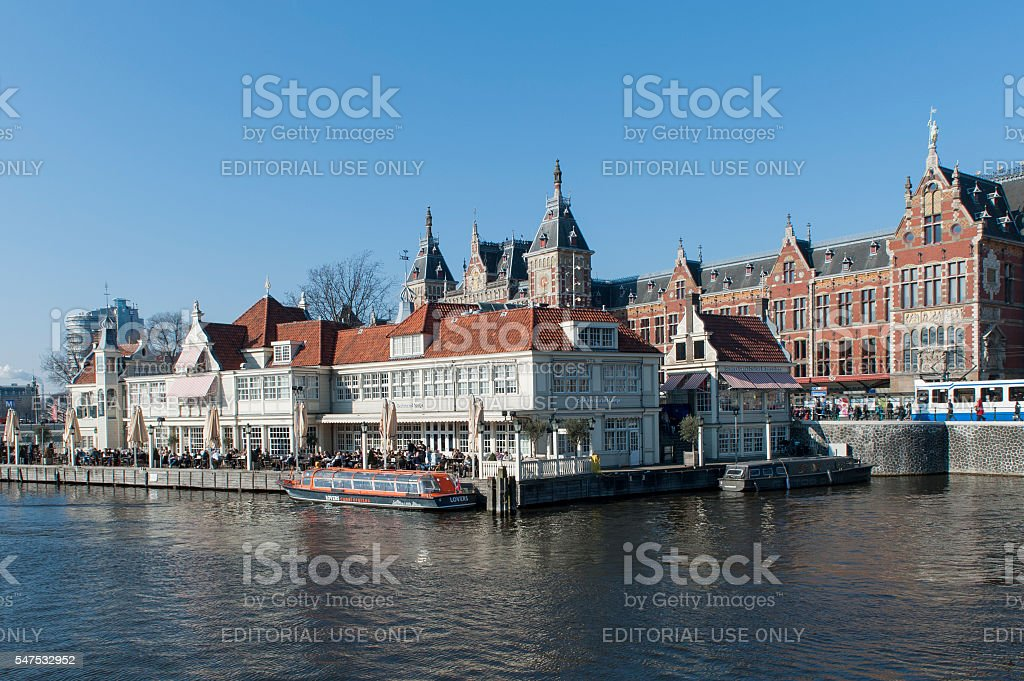 Amsterdam Central Station and restaurant on the waterfront stock photo