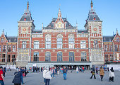 Amsterdam central station panorama with people walking in the square