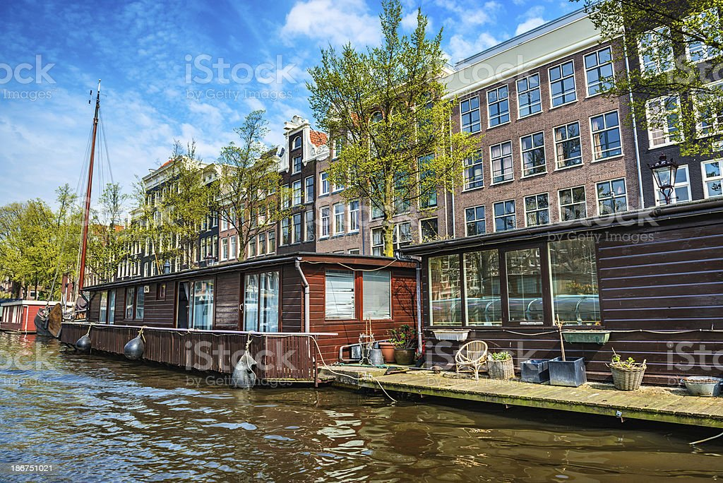 Amsterdam City Scene with Canal and House boats royalty-free stock photo