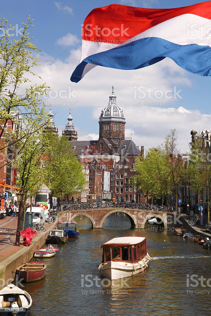 Amsterdam city with boat and flag of  Holland stock photo