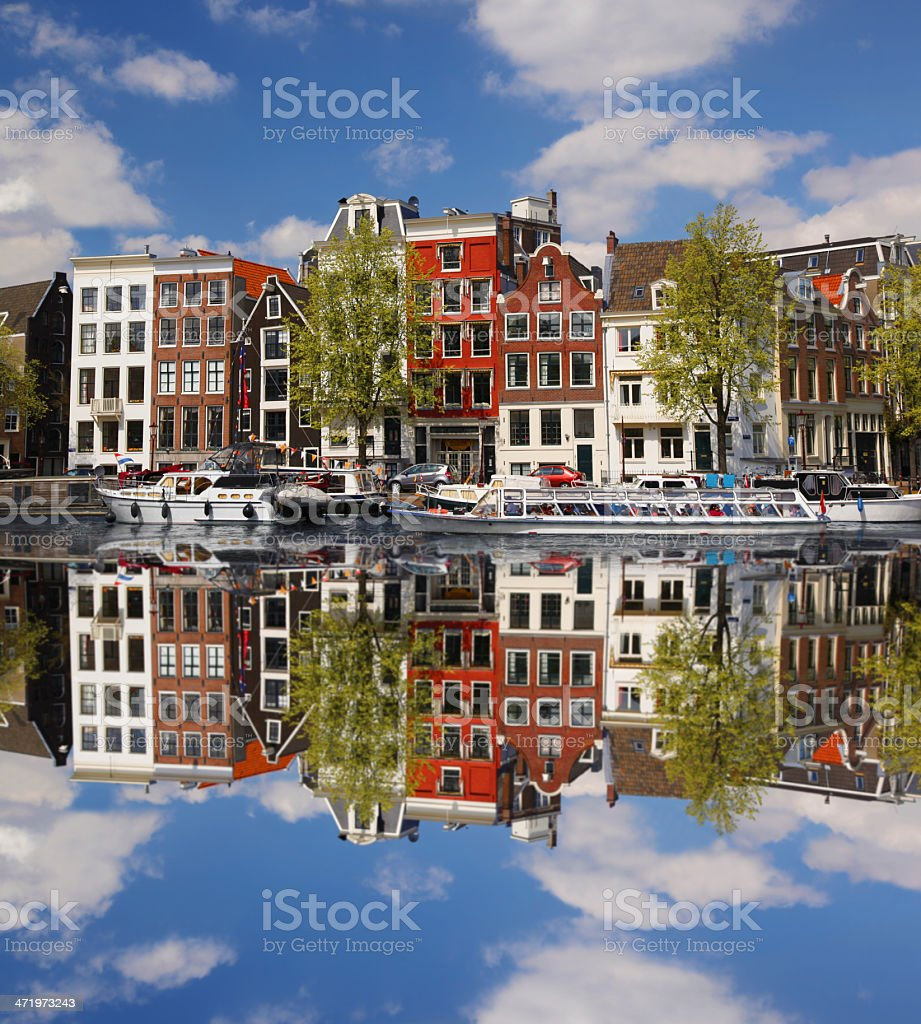 Amsterdam city with boat on canal in Holland stock photo