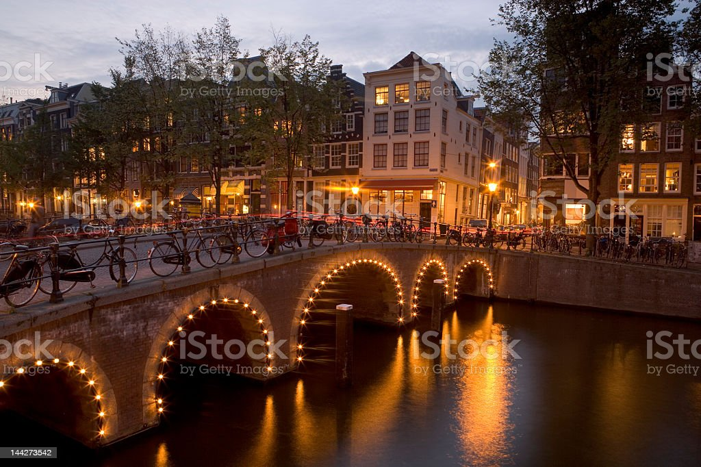 Amsterdam, Holland lit up at dusk royalty-free stock photo
