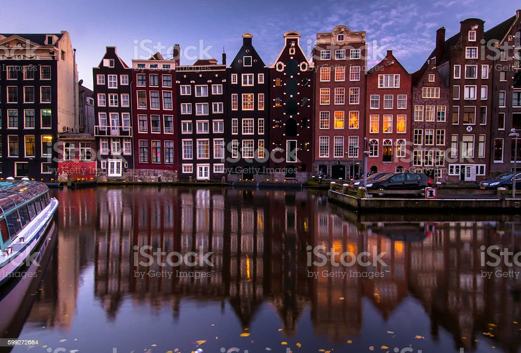 Amsterdam night city view. Old building's facade stock photo
