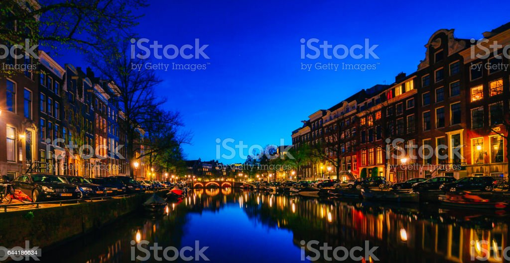 Amsterdam night cityscape with canals in Netherlands stock photo