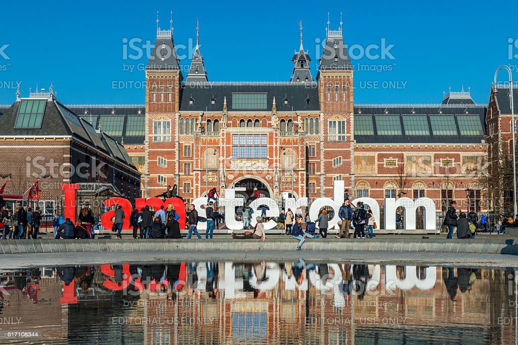 I amsterdam sign at Museumplein, Rijksmuseum in the back stock photo