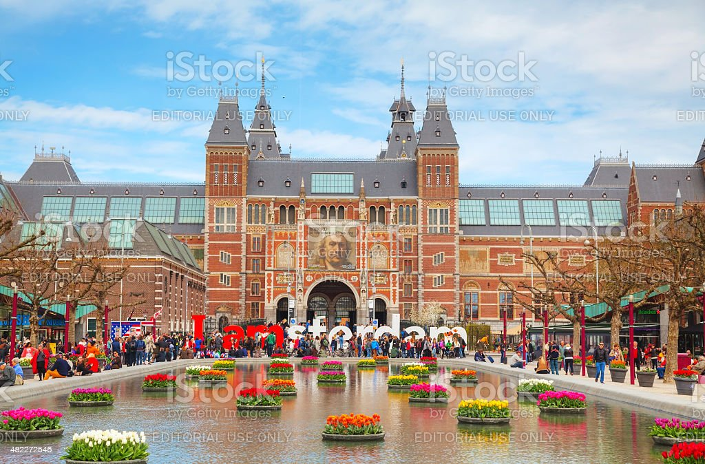 I Amsterdam slogan with crowd of tourists stock photo