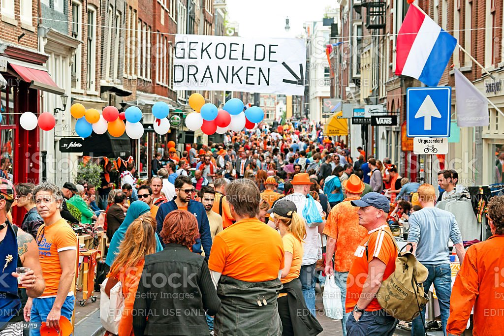 Amsterdam streets full of  people at kingsday in Netherlands stock photo