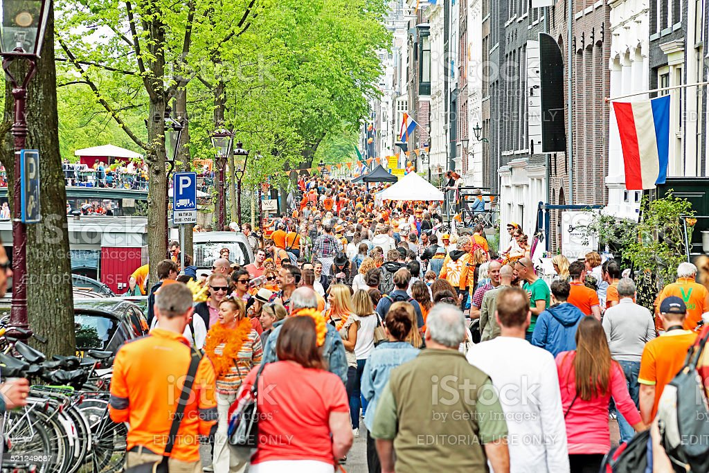 Amsterdam streets full of  people at the celebration on kingsday stock photo
