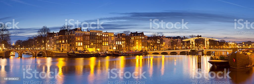 Amsterdam, The Netherlands and Amstel River at night stock photo