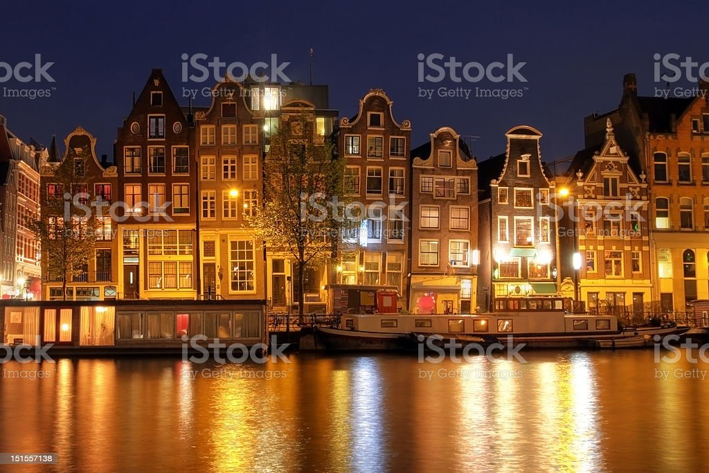 Amsterdam waterfront houses at night, The Netherlands stock photo