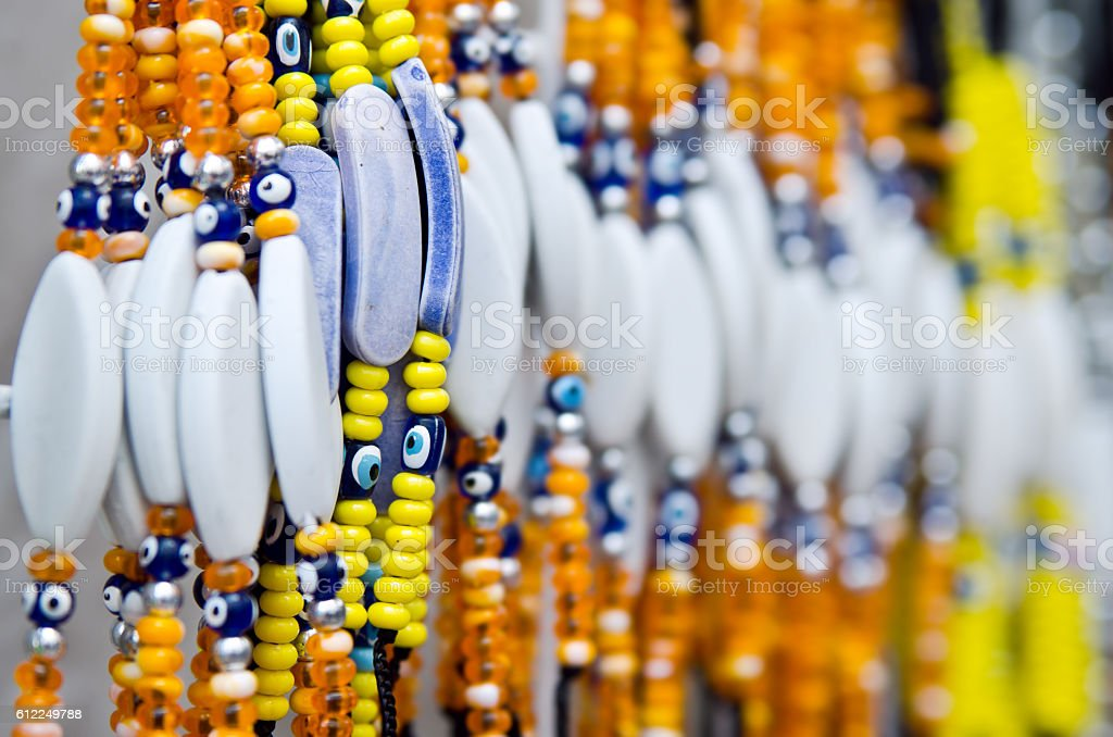 Amulet against the evil eye Nazar bondzhuk on bracelets stock photo