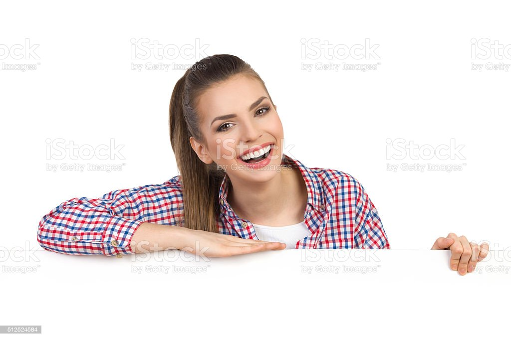 Amused Girl Behind Banner stock photo