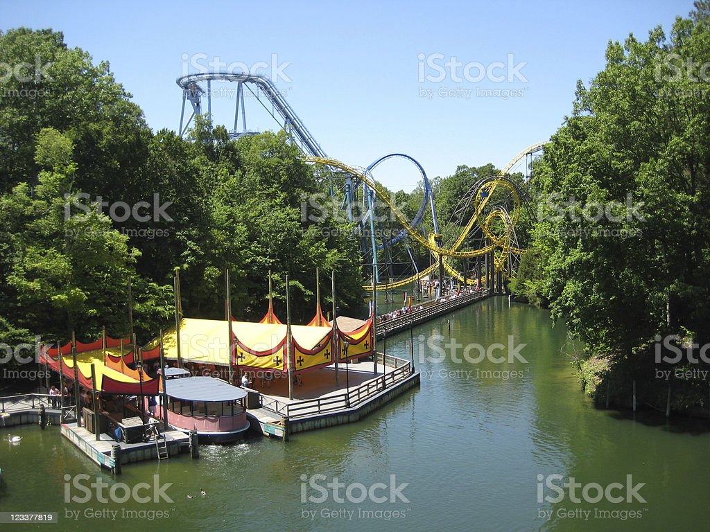 Amusement park by the water with ferries stock photo