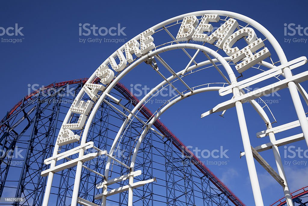 Amusement Park entrance with rollercoaster royalty-free stock photo