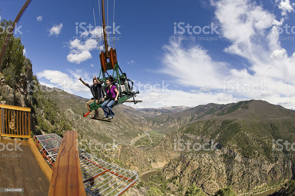 Amusement Park Ride with Man and Woman on Swing stock photo
