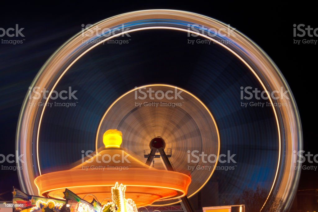 amusement park, spinning carousels royalty-free stock photo