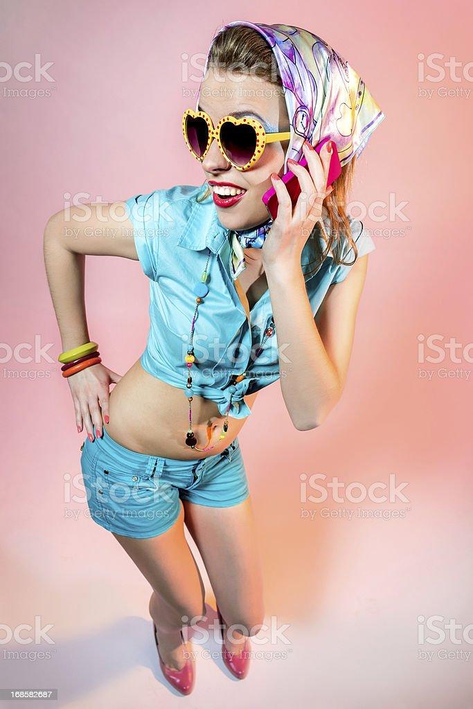 Amusing blonde with phone stock photo