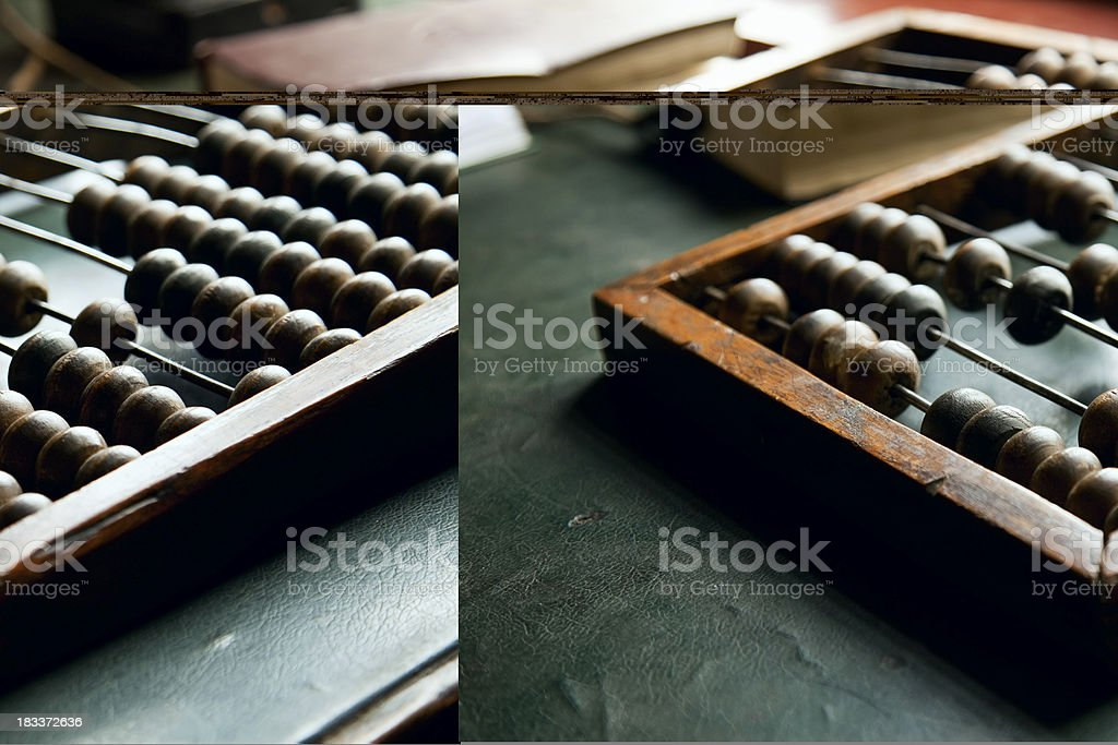 An abacus laying on a green table stock photo