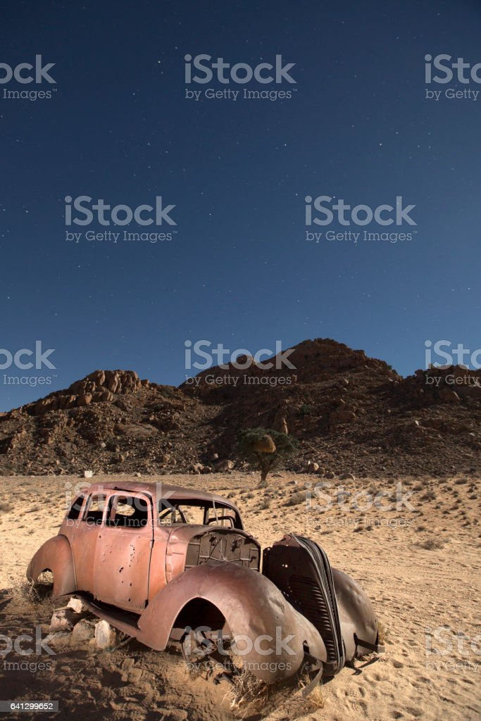 An abandon diamond smugglers car at midnight. stock photo