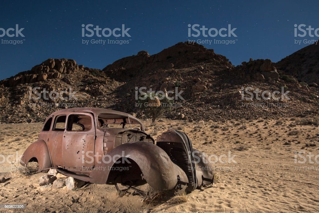 An abandon diamond smugglers car at midnight. stock photo