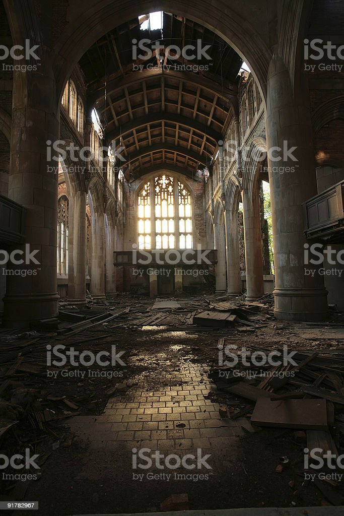An abandoned, dark cathedral with damaged floors stock photo
