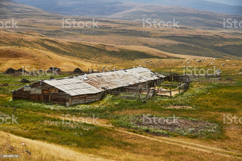 An abandoned house in the steppe, a barn for animals. The Ukok Plateau In The Altai. Fabulous cold landscapes. Anyone around stock photo